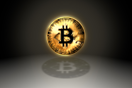 Bitcoin gold coin shining facing the camera with shading on abstract background