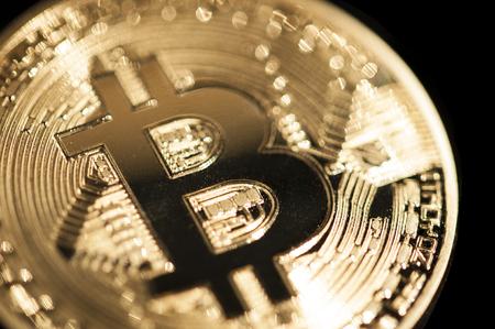 bitcoin golden coin close up detail macro shot Фото со стока