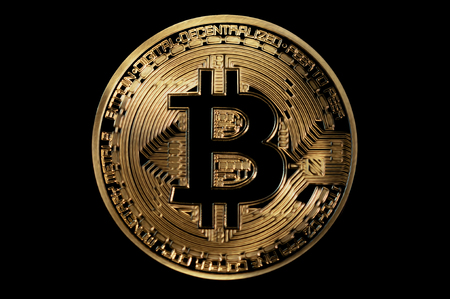 bitcoin symbol golden coin isolated on black Stock Photo