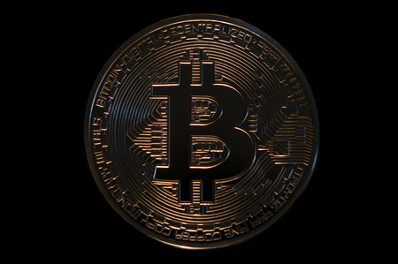 crypto digital currency bitcoin on black background Stock Photo