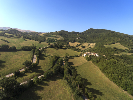 aerial shot of little village of Collevecchio, Macerata, Italy surrounded by nature of Monti Sibillini National Park