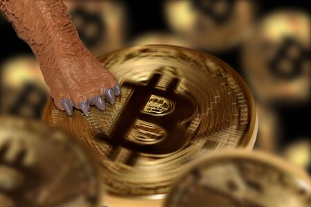 bears paw over bitcoin. bearish market trend conceptual illustration Фото со стока