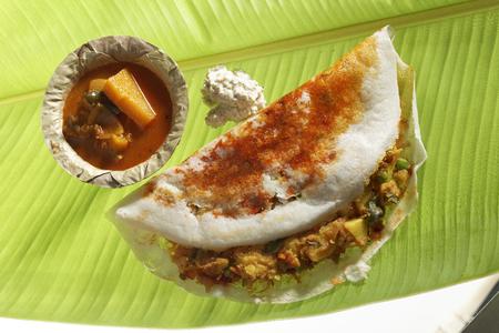 Studio shot of South Indian fast food Mysore Masala Dosa Stuffed With potato Masala Chutney And Sambhar Stock Photo