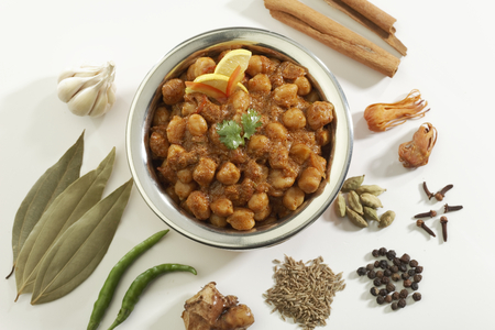 stainless steel pot: Indian Food Chana Masala in stainless steel pot. Stock Photo