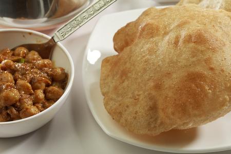 puri: Indian Food: Chana Masala and deep fried Puri. Stock Photo