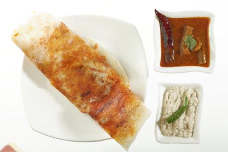 Indian fast food Mysore Masala Dosa Stuffed With Aloo Masala Chutney And Sambhar.