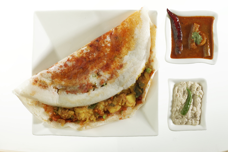 masala: South Indian fast food Mysore Masala Dosa Stuffed With potato Masala Chutney And Sambhar. Stock Photo
