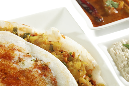 South Indian fast food Mysore Masala Dosa Stuffed With potato Masala Chutney And Sambhar. Stock Photo