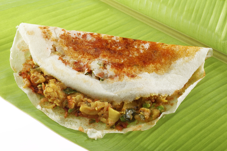 masala dosa: South Indian fast food Mysore Masala Dosa Stuffed With potato Masala Chutney And Sambhar. Stock Photo