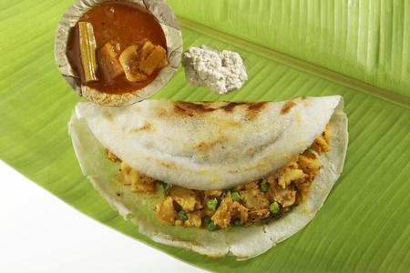 dosa: South Indian fast food Masala Dosa Stuffed With Aloo Masala Chutney And Sambhar.