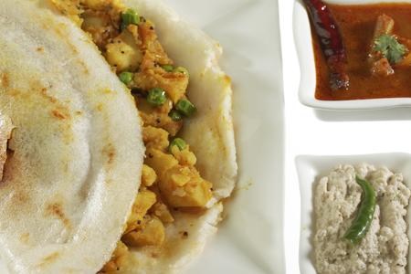 South Indian fast food Dosa Stuffed With Aloo Masala Chutney And Sambhar.