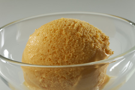 flavour: Close up of Scoop of delicious real fresh ice cream in Mango flavour.