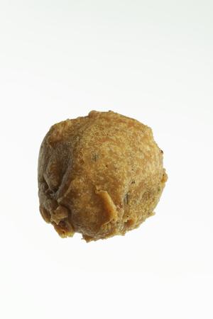 marathi: Fast food deep fried potato vada on white background.