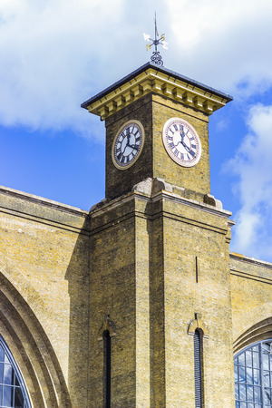 pancras: The clock of Kings cross St Pancras tube and train station in London. Stock Photo