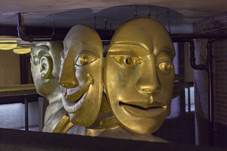 muse: London, England - May 19, 2016: The Barbican Muse is a sculpture by Matthew Spender and represents a woman holding tragedy and comedy masks in London, England.
