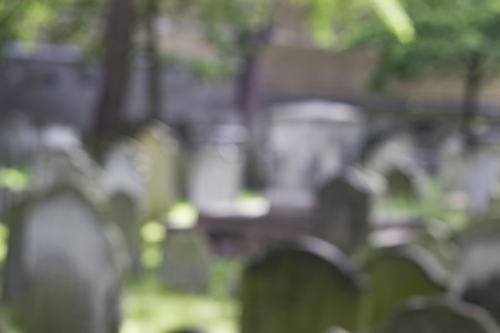 field depth: Graveyard with tombstones - shallow depth of field