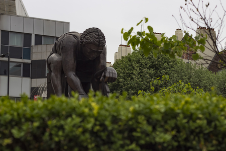 isaac: London England - May 19 2016: Statue of Isaac Newton by Eduardo Paolozzi in the British Library in London England. Editorial