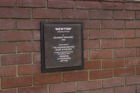 isaac newton: London England - May 19 2016: Inscription plate of Isaac Newton by Eduardo Paolozzi in the British Library in London England.