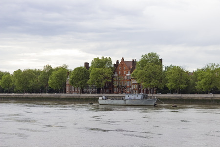 houses row: Row of British houses alongside the Thames River.