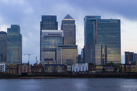 sun rise: London, England - June 13, 2016: A view of the Business, Finance and Economy district of London right before sun rise.