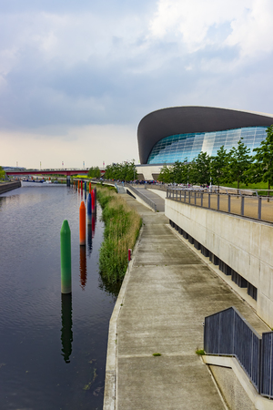 piscina olimpica: London, England - May 27, 2016: View of the London Aquatics Centre, a former Olympics venue with pools for diving and swimming, in the area of Stratford in London, England.