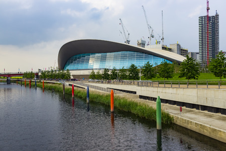 olympics: London, England - May 27, 2016: View of the London Aquatics Centre, a former Olympics venue with pools for diving and swimming, in the area of Stratford in London, England.