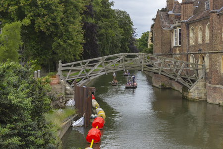 punting: Cambridge, England - July 7, 2016: Tourists boating on traditional punt boats over the river in Cambridge, England.