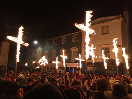 Lewes, England - 5 November 2016: Dark and crowded streets of Lewes for the fire parade of the yearly celebration of the Bonfire night festivities.