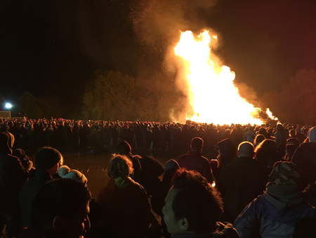 Lewes, England - 5 November 2016: Crowd gathering around the great bonfire of the yearly celebration of the Bonfire night festivities.