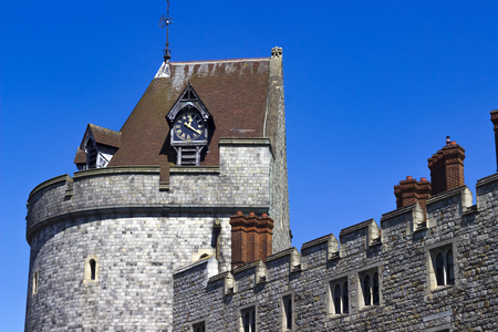 windsor: Windsor, United Kingdom - 26 May 2017: Clock and clocktower of Windsor Castle on a sunny day.