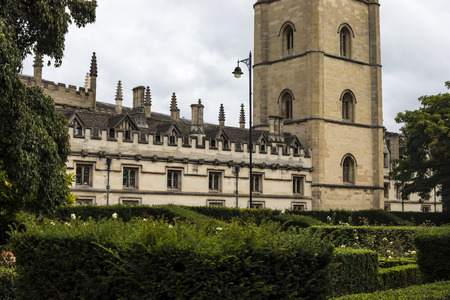 Oxford, United Kingdom - 3 September 2017: Street view in the city of Oxford with tower of Magdalen College