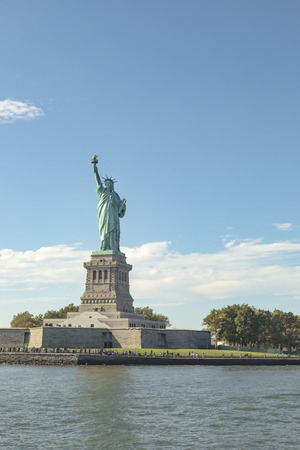 i i  i i toga: View of the Statue Of Liberty and its pedestal in New York City surrounded by Hudson River