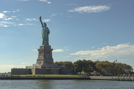 View of the Statue Of Liberty and its pedestal in New York City surrounded by Hudson River