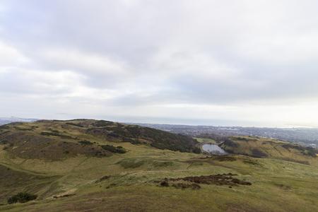 Background image of the park of Holyrood in Edinburgh, Scotland.