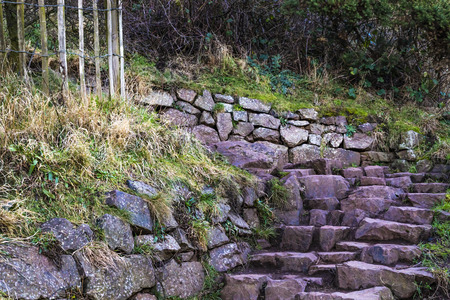 Stairway made of ancient stone blocs found in the park of Holyrood in Scotland.