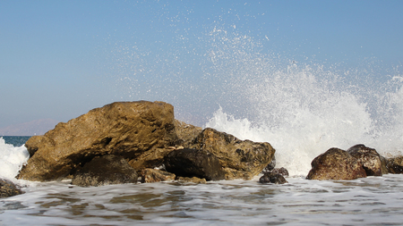 Powerful sea waves hitting rocks by the shore. Shot in 4K and 25fps.