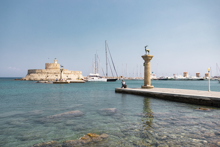 Rhodes, Greece - August 4, 2018: View of the iconic Colossus of Rhodes in the harbour of the city. 新闻类图片