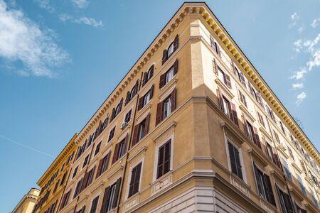 View of a traditional house building architecture with windows in Rome in Italy. 스톡 콘텐츠 - 131953297
