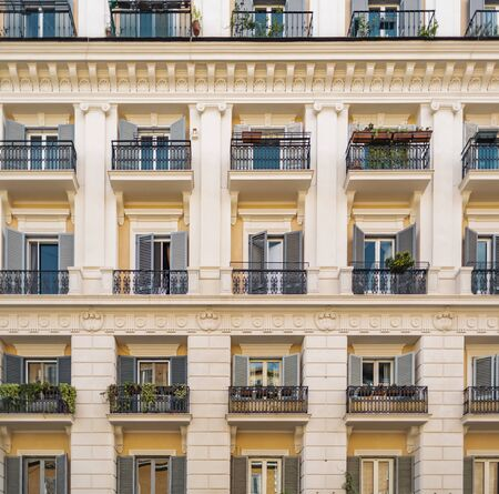 View of a traditional house building architecture with windows in Rome in Italy. 스톡 콘텐츠 - 131953231