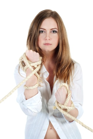 Portrait of young woman holding ropes isolated on white photo