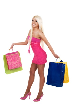 Portrait of stunning young woman carrying shopping bags over white background photo