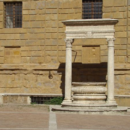 famous water well from Tuscan papal town Pienza                                photo