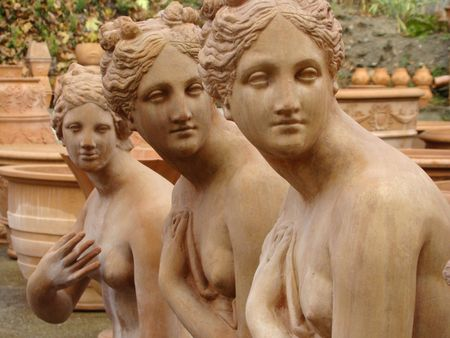 loveliness:     three graces, terracotta statues from Italy