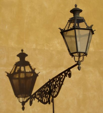 antique lamp with shadow in Florence photo