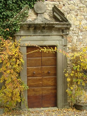 nook: romantic entrance to the historic building in Tuscany
