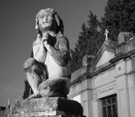 ancient figure on florentine cemetery, Italy                            photo