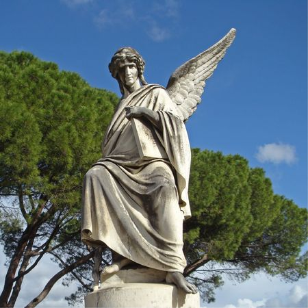 angel tree:  antique angelic sculpture on monumental florentine cemetery, Italy