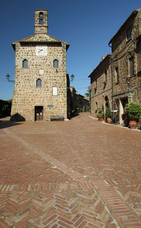 Main piazza in etruscan small town in Tuscany, Sovana, Italy photo