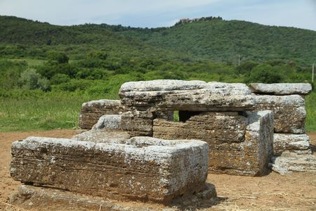 etruscan: etruscan tomb in Baratti and etruscan Populonia settlement on hill, Italy