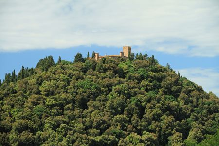 castle on green hill, Tuscany photo